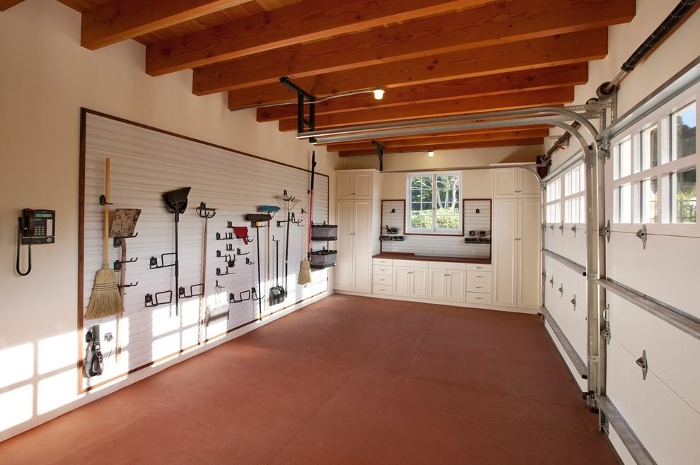 Garage - traditional two-car garage idea in Santa Barbara