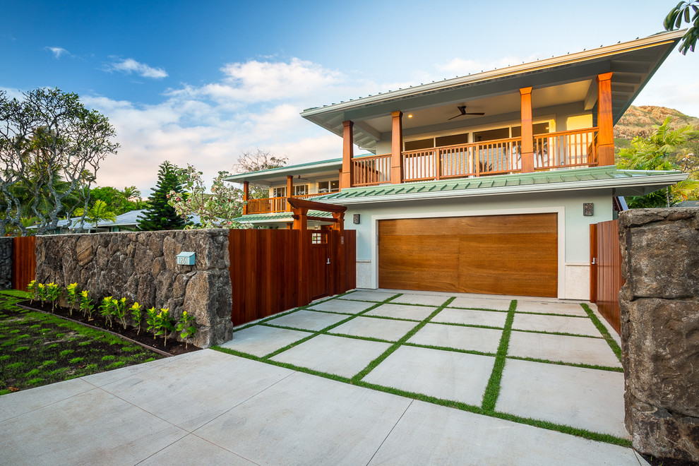 Large island style attached two-car garage photo in Hawaii