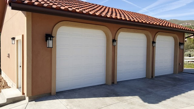 Inspiration for a large modern detached three-car porte cochere remodel in Other