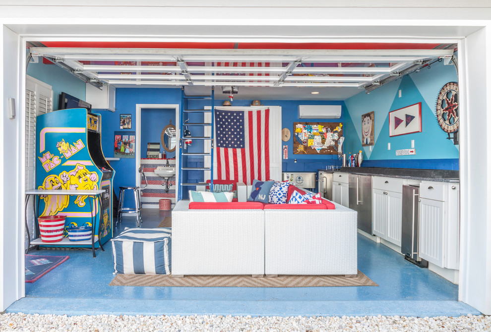 Example of a mid-sized beach style two-car garage workshop design in New York