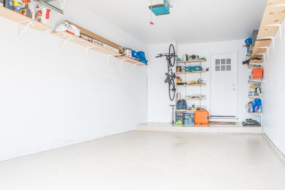Small trendy attached one-car garage workshop photo in Chicago