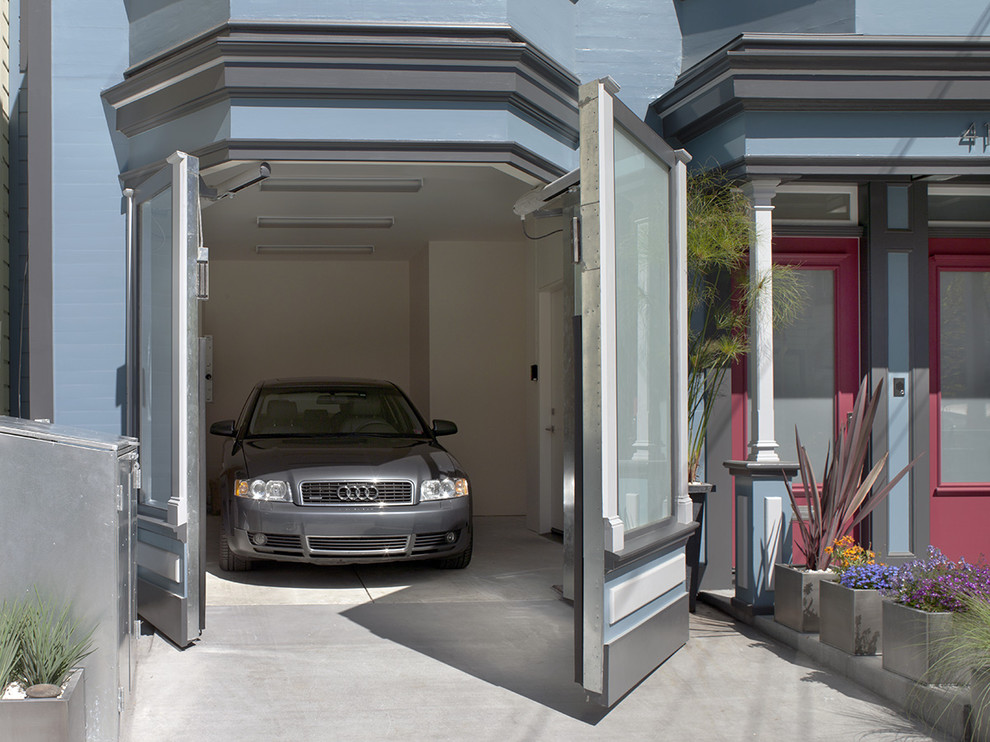 Inspiration for a victorian attached one-car garage remodel in San Francisco