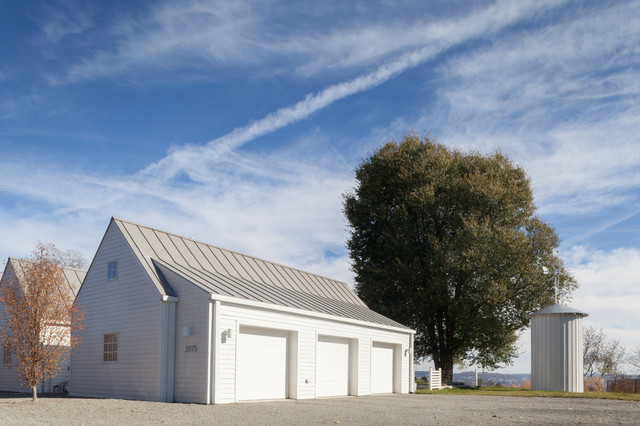 Inspiration for a farmhouse three-car garage remodel in Other