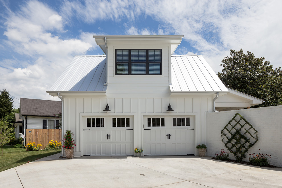 Garage - mid-sized country attached two-car garage idea in Nashville