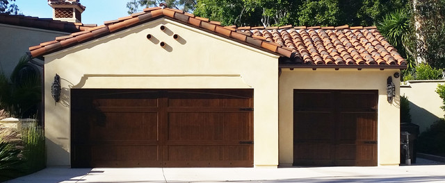 New House Spanish Garage Doors Up Close Mediterranean Garage