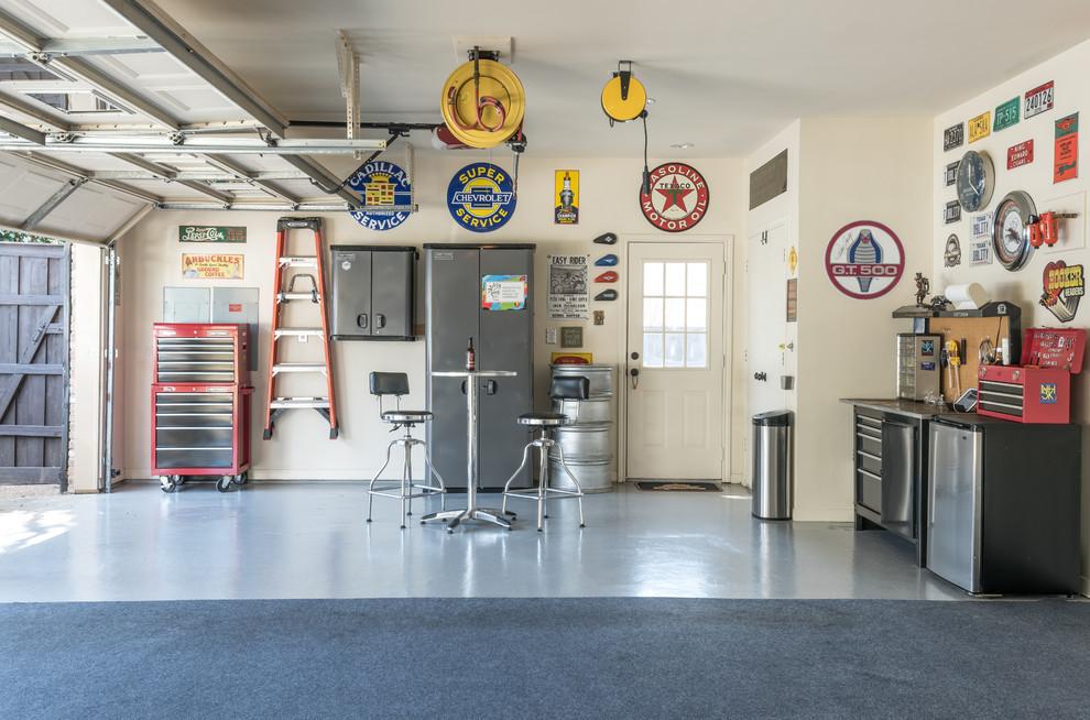 Inspiration for an industrial garage workshop remodel in Dallas