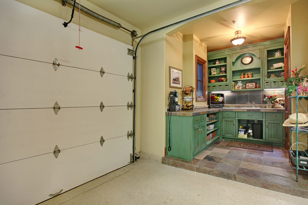 Example of a cottage chic one-car garage workshop design in Orange County