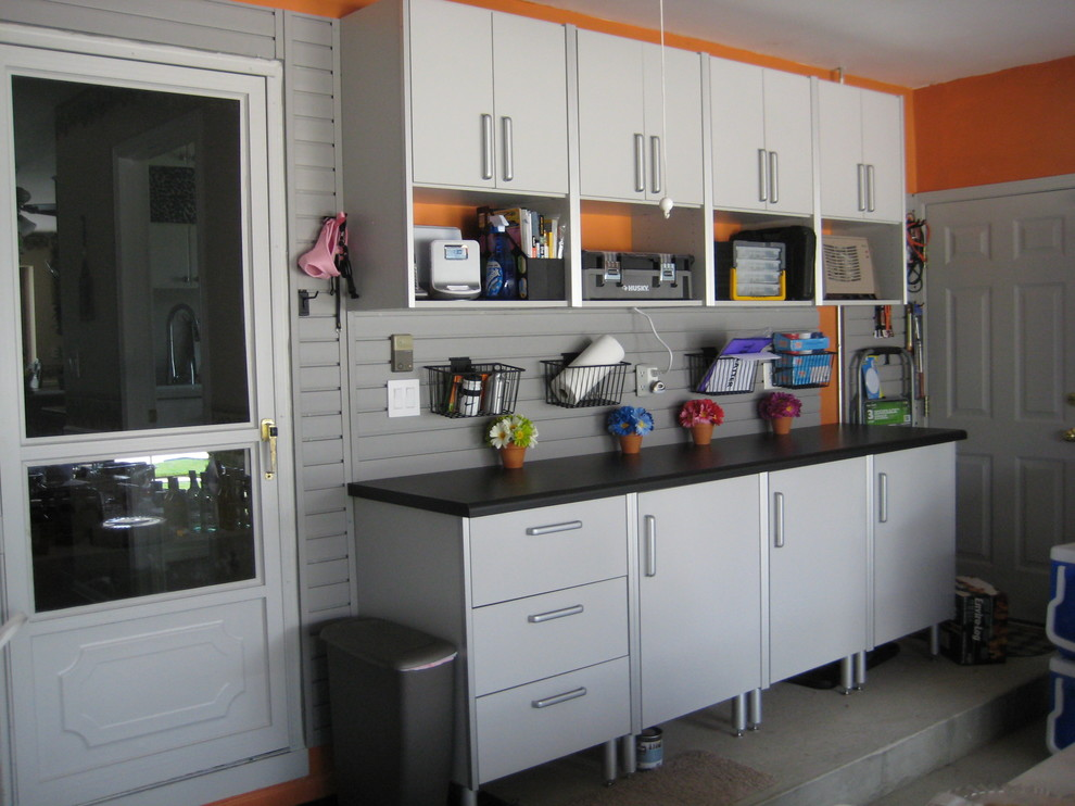 Inspiration for a mid-sized contemporary attached two-car garage workshop remodel in Detroit