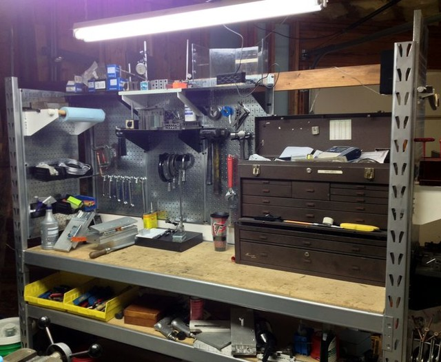 Industrial Garage Storage : Pegboard workstation and tool storage area created out of