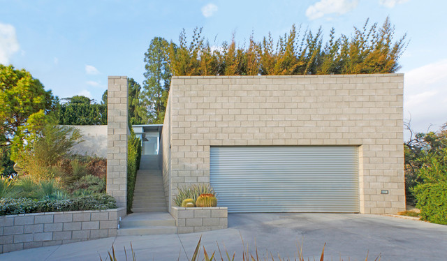 of a well designed modern one car garage and shed in los angeles