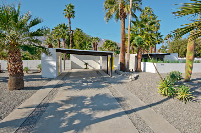 Example of a midcentury modern carport design in Other
