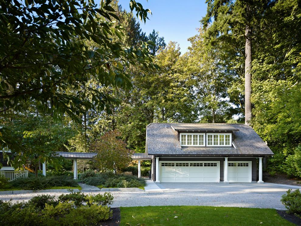 Garage - traditional detached three-car garage idea in Seattle