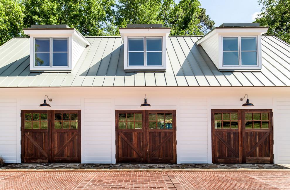 Garage - cottage detached three-car garage idea in Raleigh