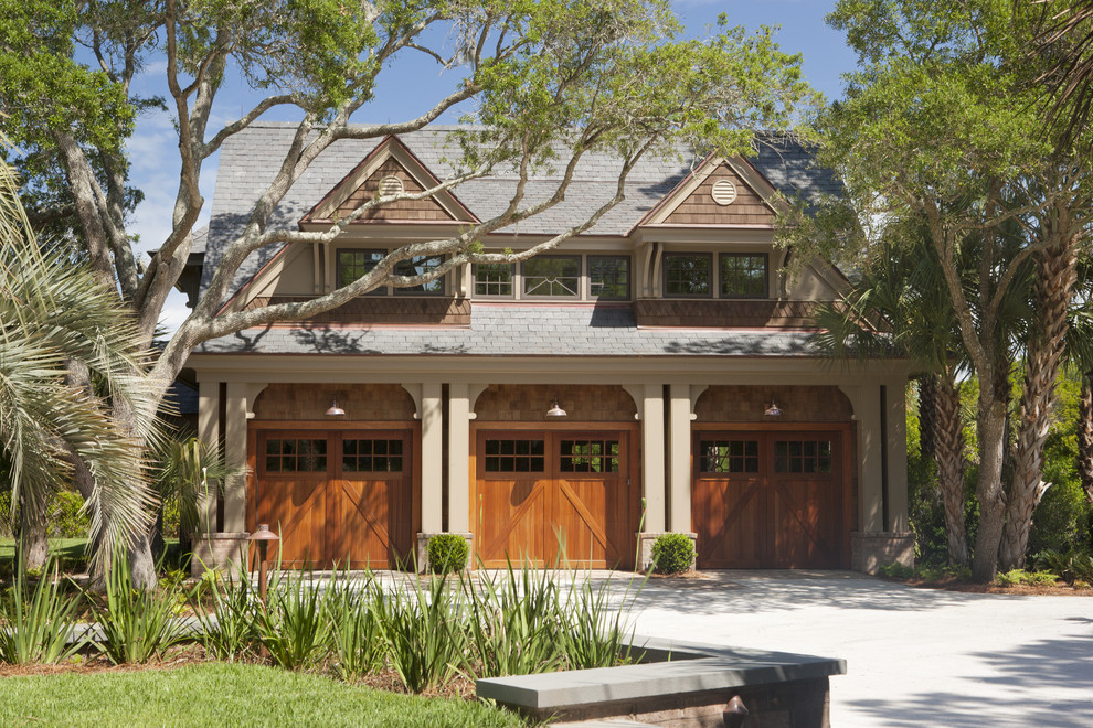 Example of a large ornate detached three-car garage design in Charleston