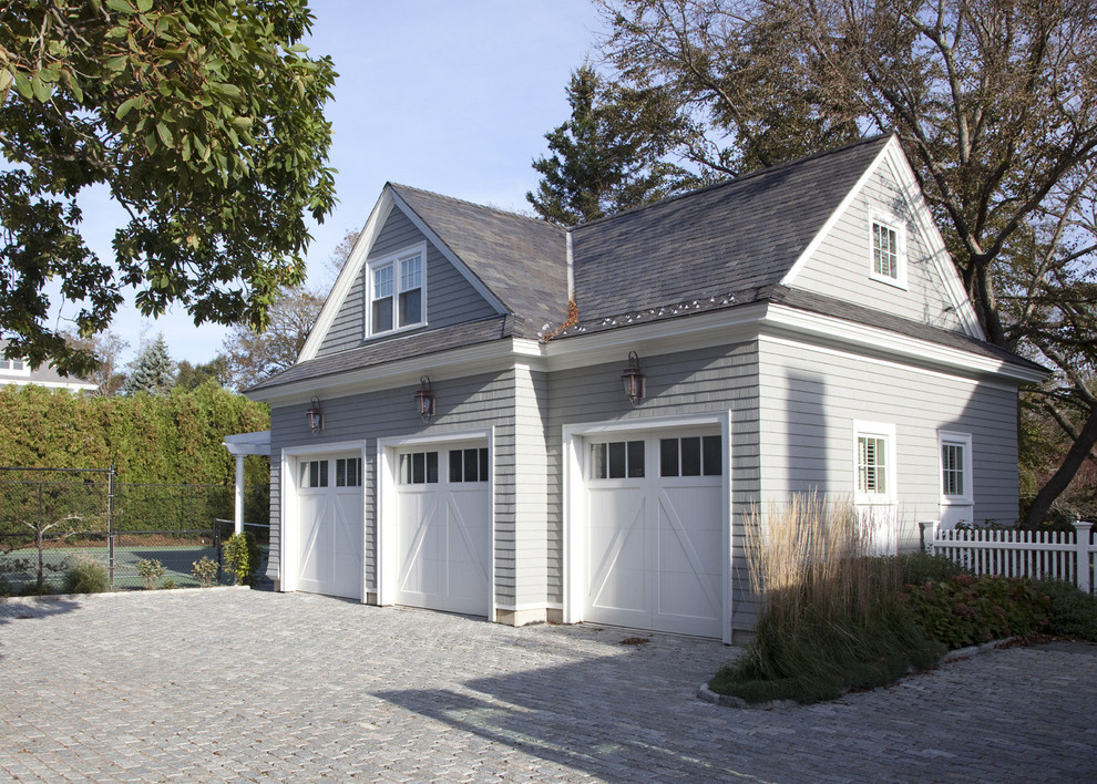 Inspiration for a timeless three-car garage remodel in Boston