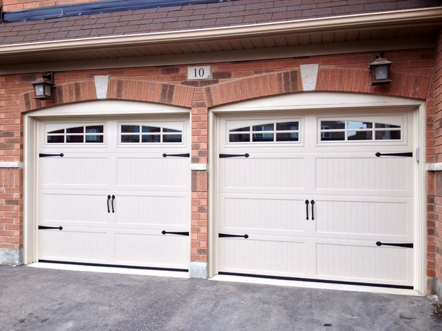 Steel insulated garage doors farmhouse garage for Farmhouse garage doors