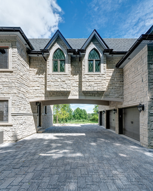 Huge ornate three-car porte cochere photo in Other