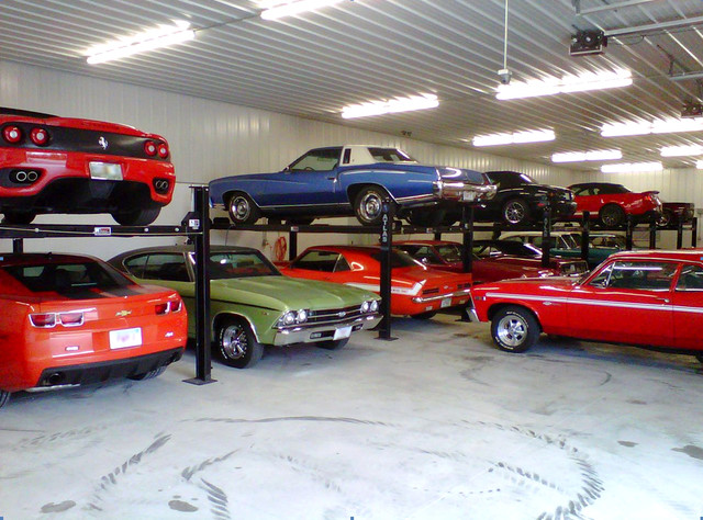 Storage lifts for multi car collection modern garage for Multi car garage