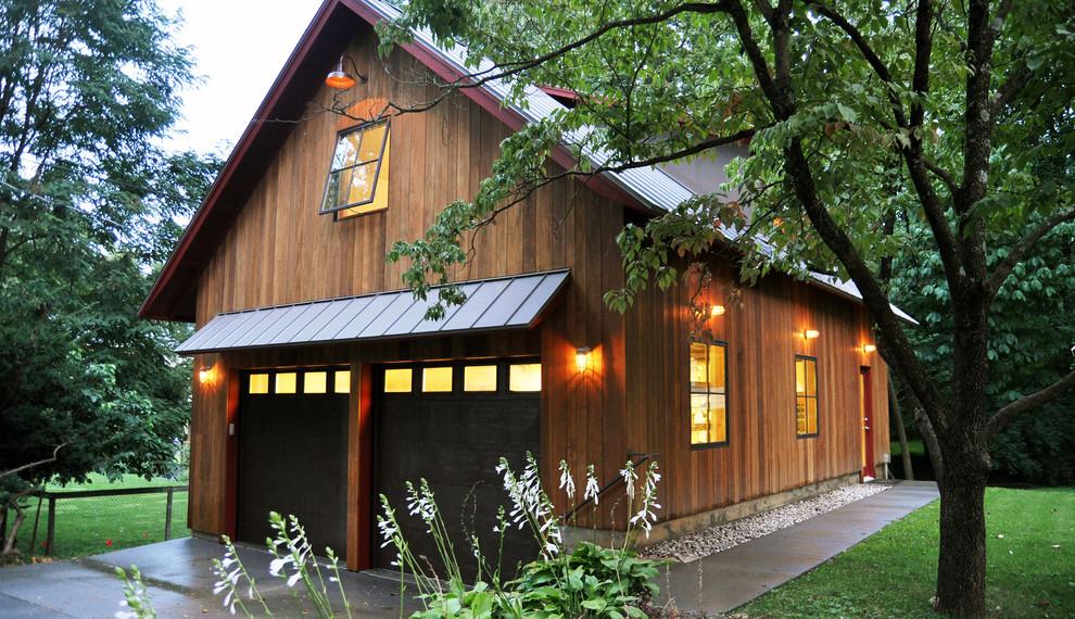 Garage workshop - large rustic detached two-car garage workshop idea in Louisville