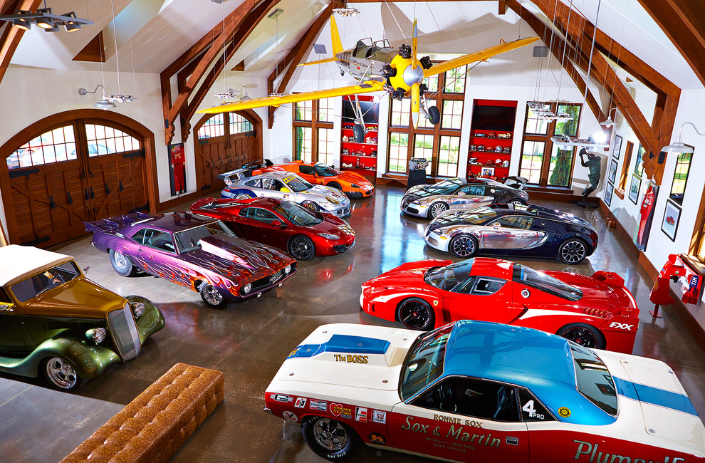 Large eclectic four-car garage photo in Tampa