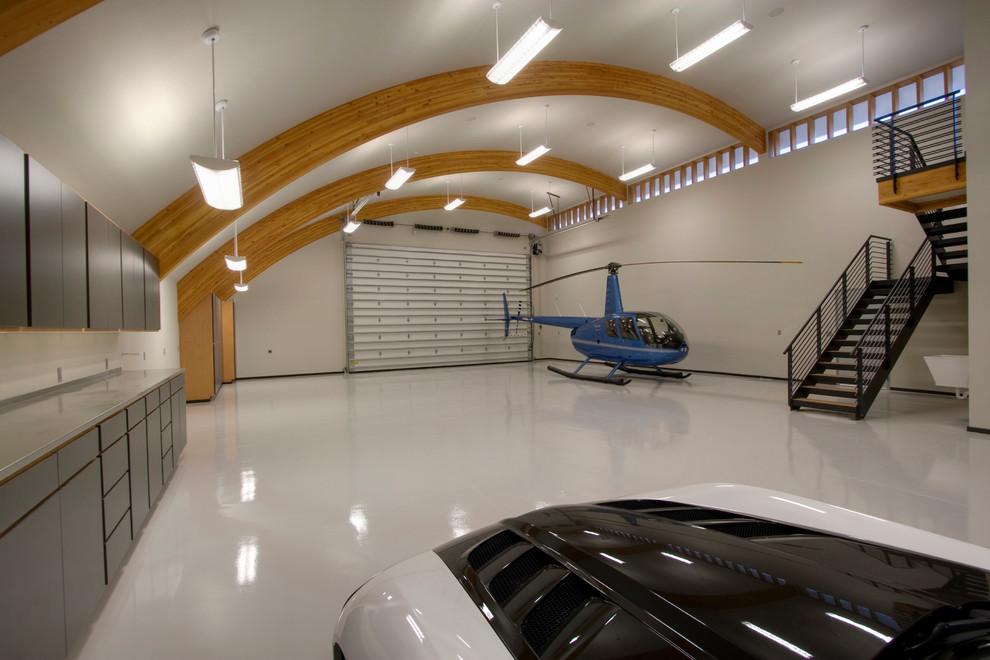 Garage - contemporary three-car garage idea in Seattle