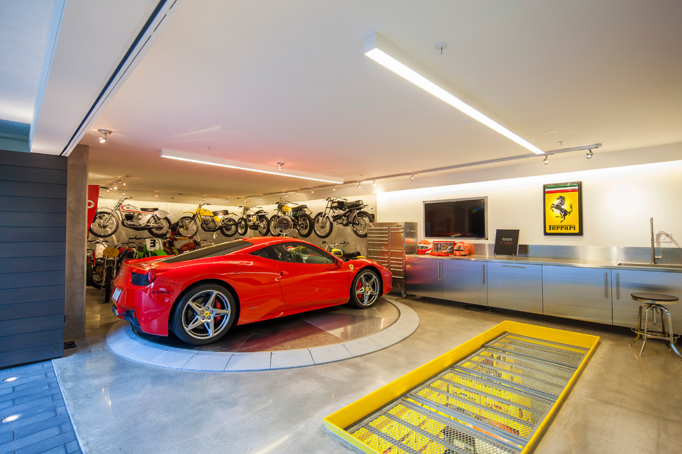 Inspiration for a mid-sized contemporary one-car garage workshop remodel in Orange County