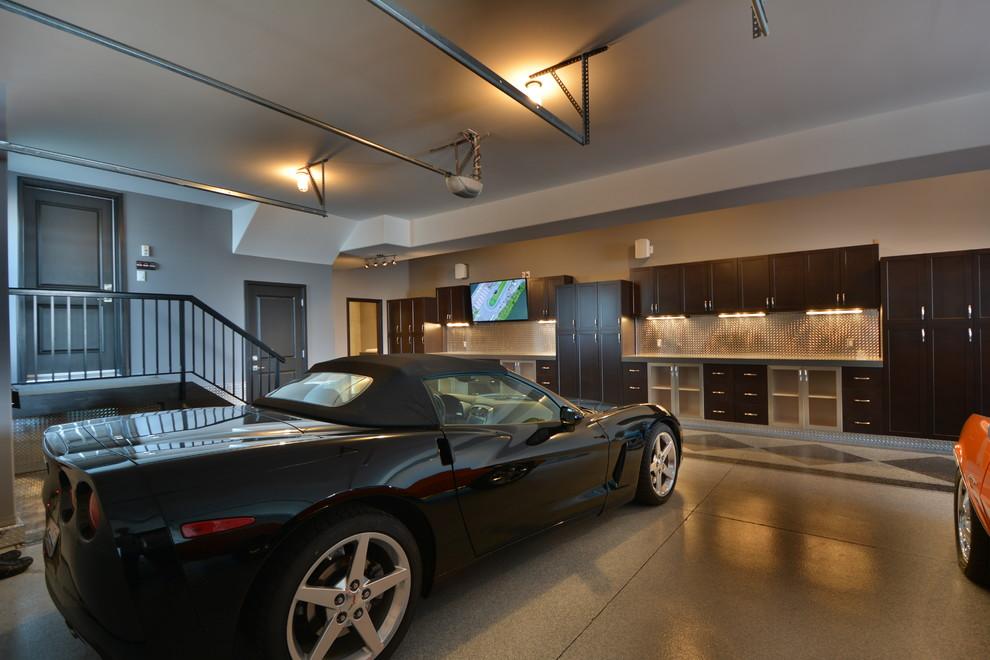Garage - huge industrial attached three-car garage idea in Edmonton