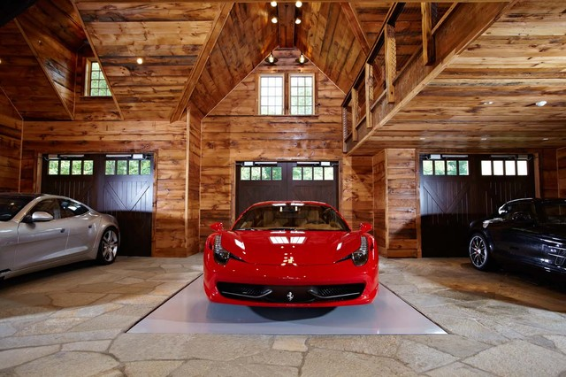 Ultimate man cave and sports car showcase for Luxury garage interiors
