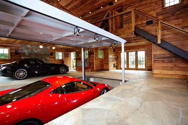 Ultimate man cave and sports car showcase traditional for Cool car garage ideas