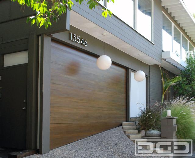 Uneven threshold garage floor with a custom made garage door by