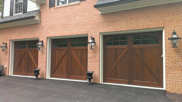 Wood and composite carriage garage doors traditional for Composite wood garage doors