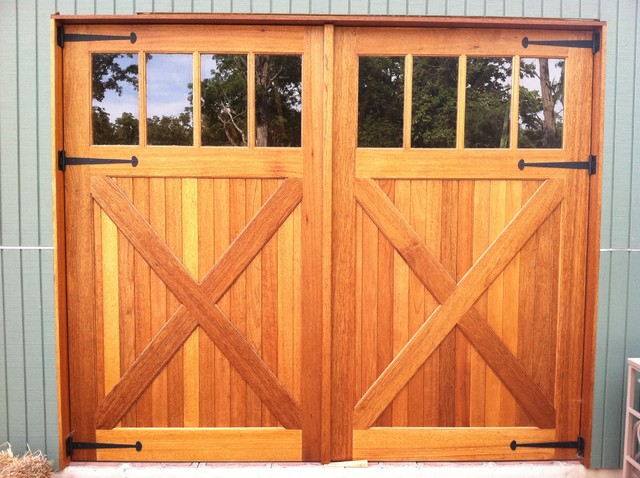 Wood garage doors and carriage doors rustic garage for Carriage style garage doors for sale