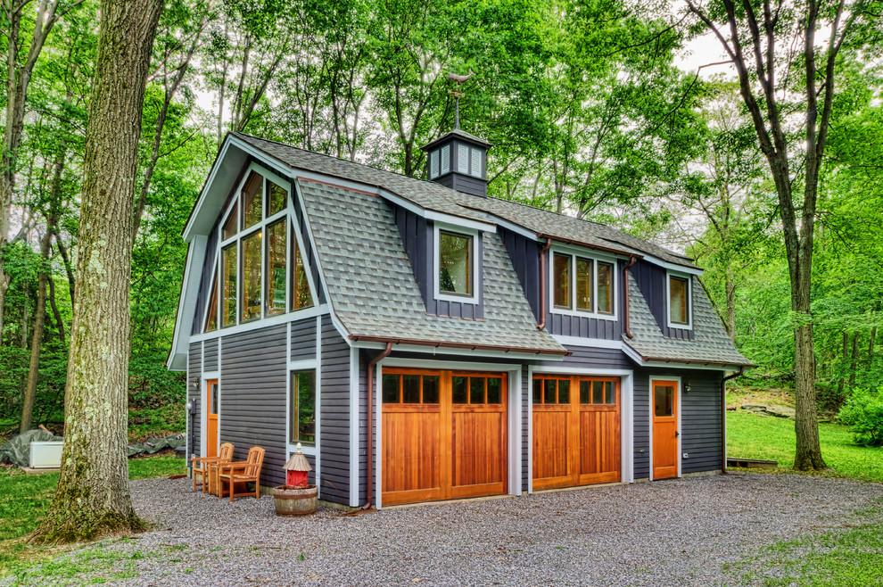 Garage workshop - cottage detached two-car garage workshop idea in New York