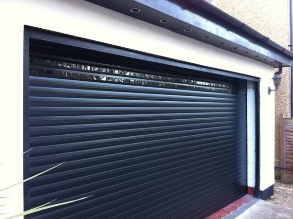 Changing a wooden garage door to a roller garage door for Garden shed with roller door