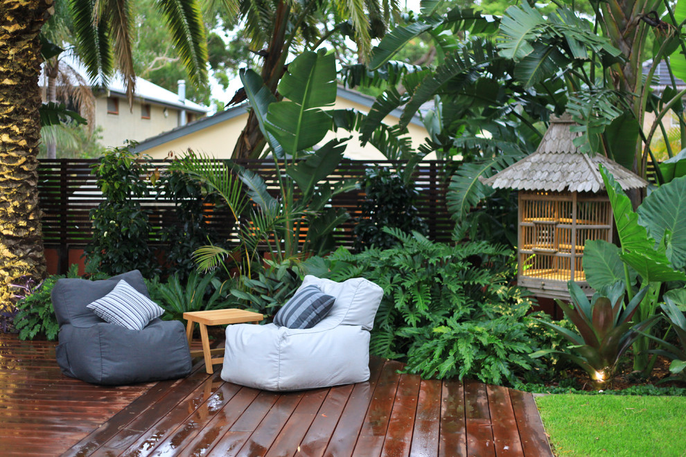 Design ideas for a large asian partial sun backyard landscaping in Sydney with decking.