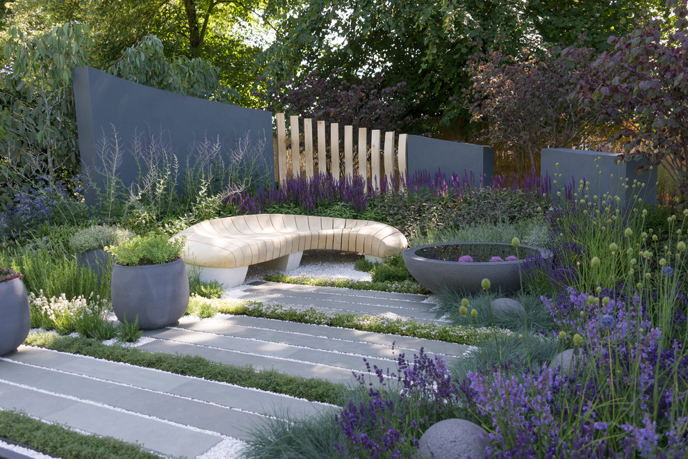 Inspiration for a mid-sized contemporary full sun backyard stone pond in Berkshire.