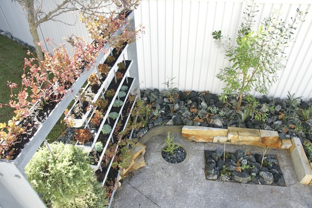 Contemporary Garden With Deck And Vertical Garden