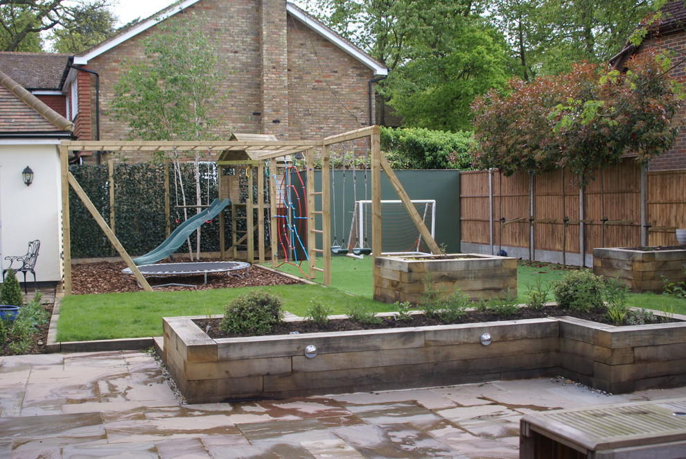 Design ideas for a mid-sized rustic partial sun backyard landscaping in Hertfordshire.
