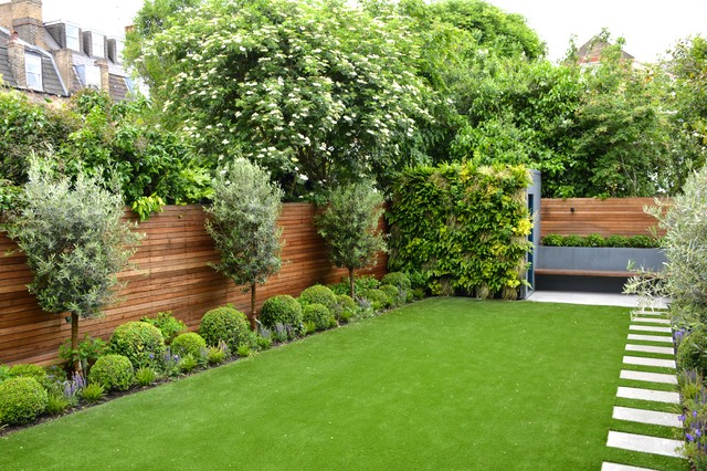 Wonderful Design Ideas For A Mid Sized Contemporary Full Sun Backyard Stone  Landscaping In London.