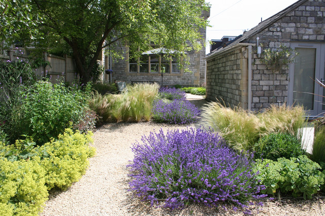Photo of a rustic gravel formal garden in Other for spring.