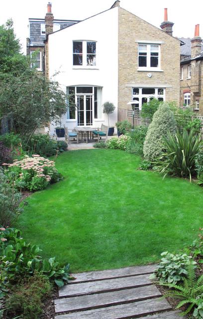 A Curvy Lawn And All Season Plants Soften A Rectangular Yard