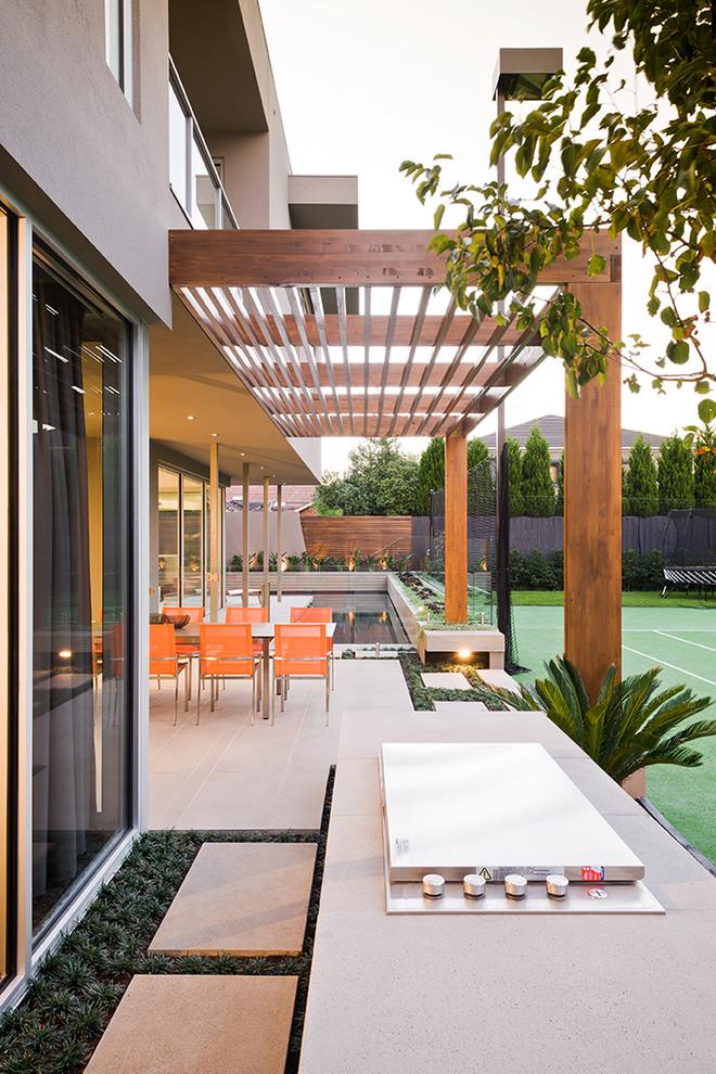 Design ideas for a large contemporary partial sun backyard outdoor sport court in Melbourne.