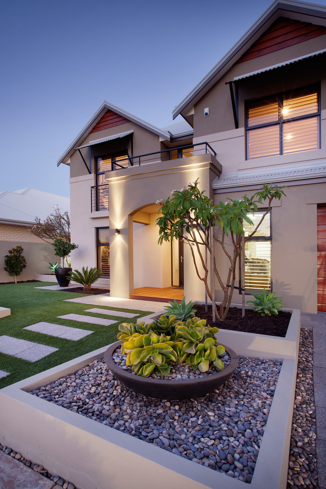 This is an example of a mid-sized contemporary full sun front yard concrete paver landscaping in Perth for summer.