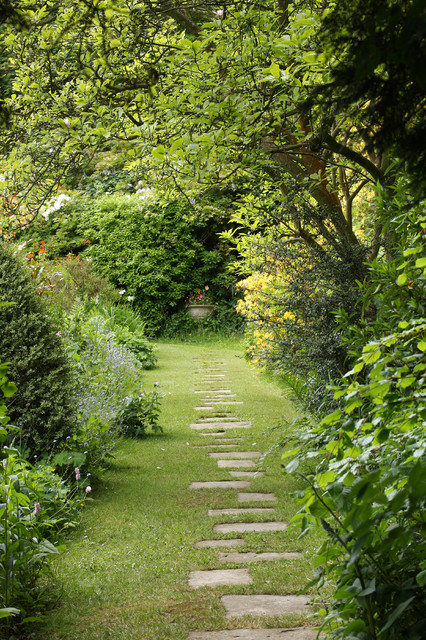 Design ideas for a large classic back partial sun garden in Hampshire with a garden path and natural stone paving.