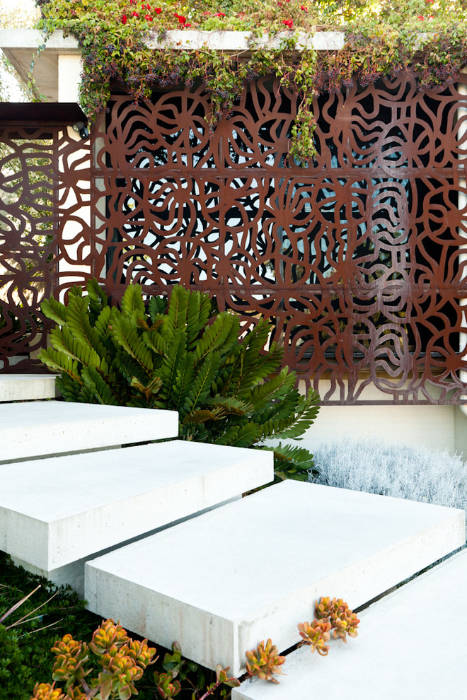 Photo of a contemporary shade backyard brick landscaping in Perth.