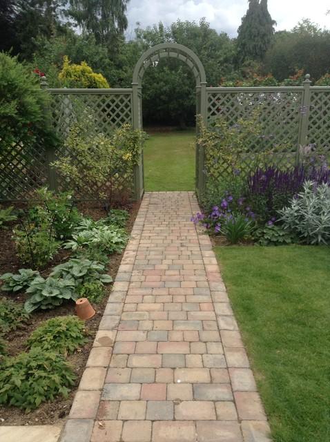 Long garden with trellis divider and rose arch for Garden divider ideas