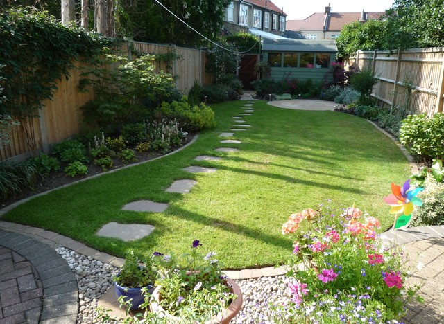 Narrow back garden traditional garden surrey by for Back house garden design