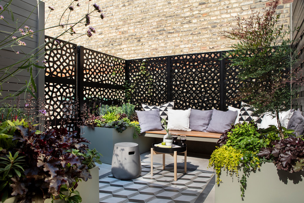 This is an example of a small contemporary landscaping in London.