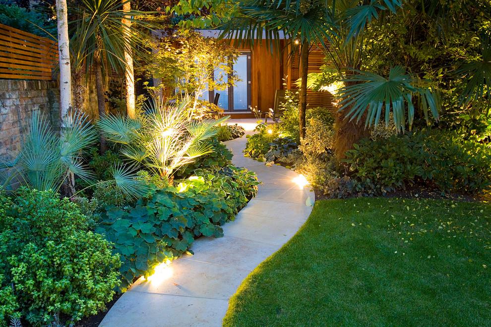 Inspiration for an asian backyard concrete paver garden path in London.