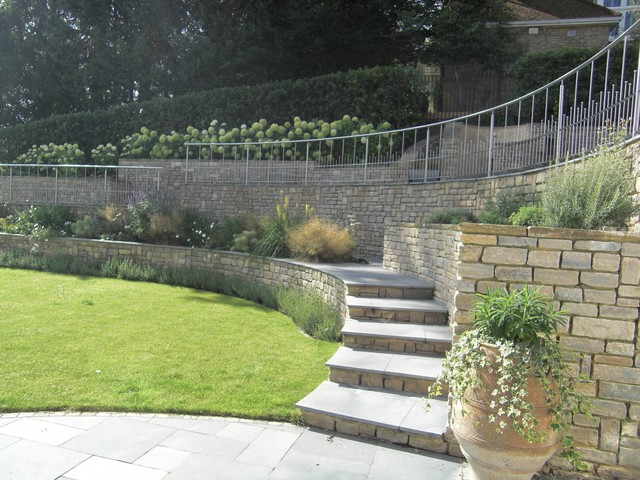Steeply sloping large garden in surrey uk modern for Garden design solutions